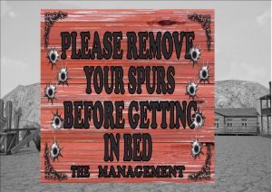 Remove Your Spurs Sign