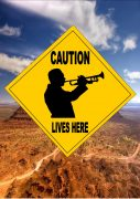 Caution trumpeter Lives Here Sign